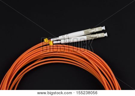 Fiber optic patchcord LC on dark background.