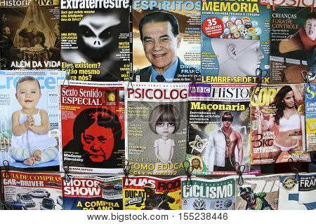 RIO DE JANEIRO BRAZIL - JAN 31 2015: titels of magazines at a kiosk in Rio. Glamor and crime is still a very potential selling issue in Newspapers and periodical magazines.