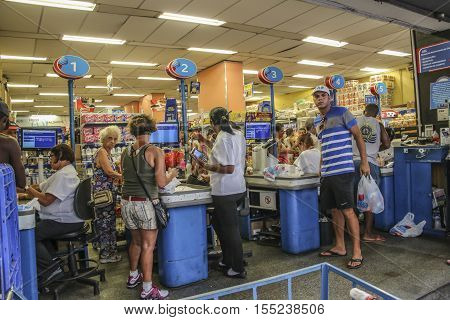 People At The Cash Point Of A Super Market In Rio