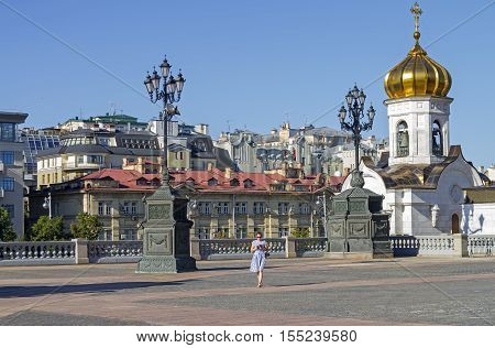 MOSCOW RUSSIA - AUGUST 28 2016 : A fragment of the square at the Christ the Savior Cathedral in Moscow. View towards Soymonovsky proezd. Sunny August morning.