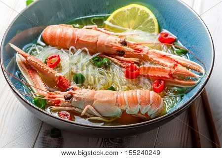 Closeup Of Thai Soup With Scampi And Noodles