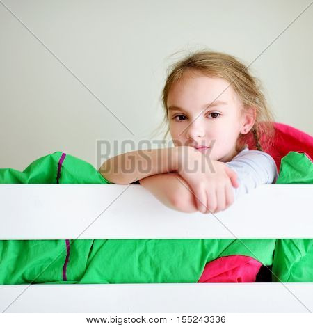 Adorable Little Girl Having Fun In Twin Bunk Bed