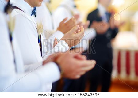 Groomsmen During Catholic Wedding Ceremony