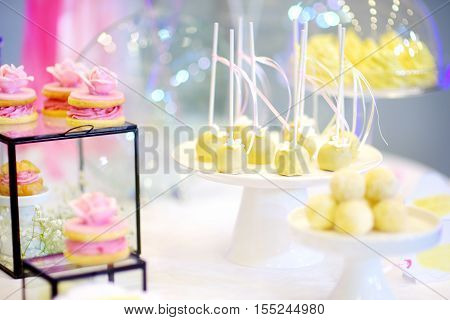Beautiful Desserts, Sweets And Candy Table At Wedding Reception