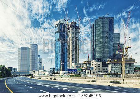Tel Aviv Cityscape In Sunrise, New Skyscraper Constraction Site and Empty Aylon Freeway.