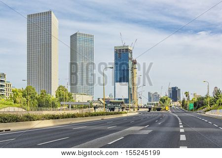 Tel Aviv Cityscape In Sunrise, New Skyscraper Constraction Site and Empty Aylon Freeway.