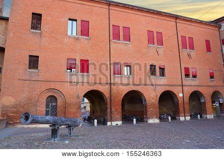The arch of Castello Estense or castello di San Michele and the cannon called 'Regina' in Ferrara - Italy