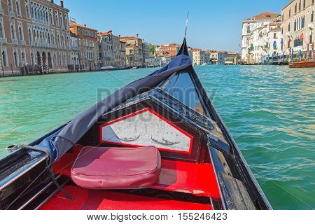 Having an excursion by venetian gondola in Venice Italy.