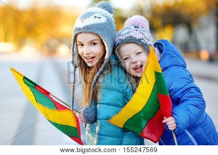 Two Adorable Little Sisters Celebrating Lithuanian Independence Day