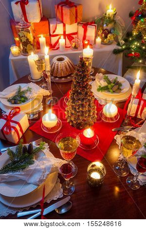 Dinning room at Christmas Eve on wooden table