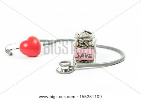 Jar of saving coin and stethoscope on white background.Saving money for medical concept