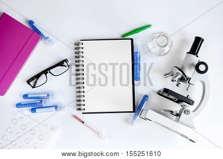 medical student working place with blank open notebook space for text top view