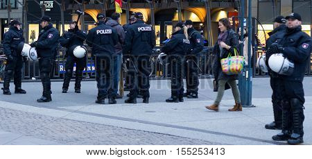 Hamburg, Germany - November 04, 2016: German Policemen watching crowd in Hamburg, Germany.