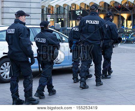 Hamburg, Germany - November 4, 2016: Policemen patrolling near Rathausmarkt in Hamburg