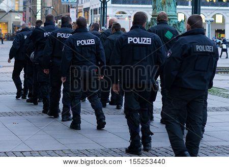 Hamburg, Germany - November 4, 2016: Policemen patrolling in Rathausmarkt, Hamburg.