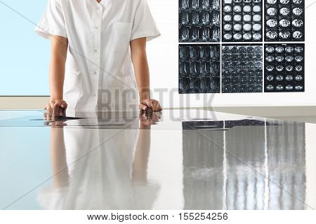 Radiologist woman checking xray healthcare medical and radiology concept