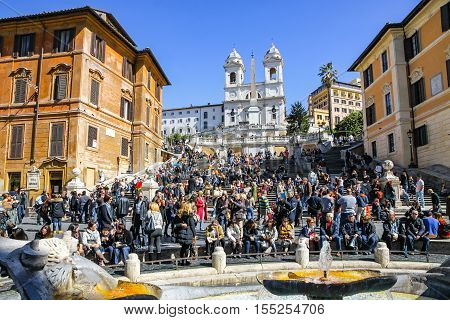 ROME ITALY - MARCH 9 2013: The Spanish Steps (Italian: Scalinata di Trinita dei Monti) are a set of steps in Rome Italy. Piazza di Spagna and fountain Fontana della Barcaccia on the foreground