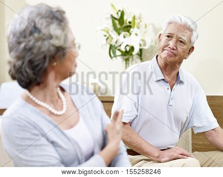 senior asian couple having a fight at home