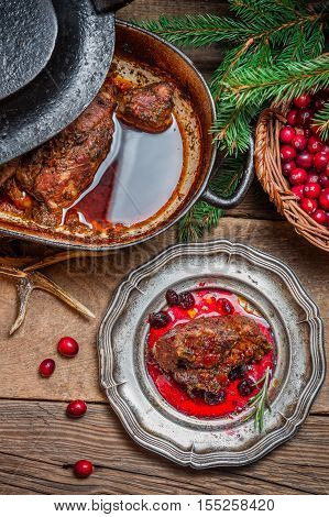 Roast Venison With Cranberry Sauce And Served In The Forester Lodge