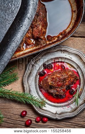 Roast Venison With Cranberry Sauce In The Woods