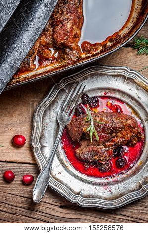View Of Venison With Cranberry Sauce And Rosemary