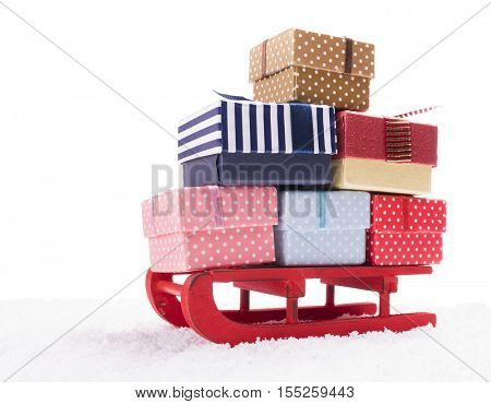 Wooden sled full of gift boxes, isolated on white background