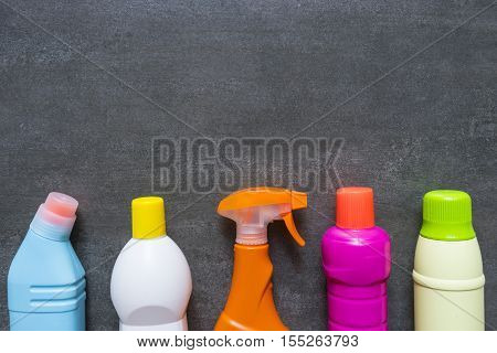 House cleaning product on black background, top view