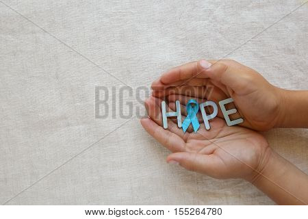 Hands Holding Hope With Light Blue, Sky Blue Ribbon, Copy Space Background, Prostate Cancer Awarenes
