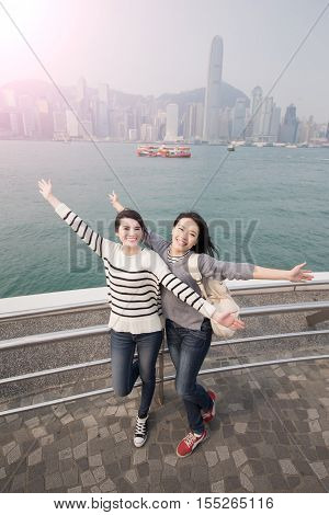 two beauty woman feel free and travel in hongkong