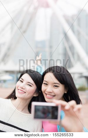two beauty woman show something and selfie in hongkong