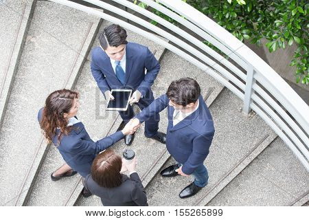 Top view of business people working together in hongkong