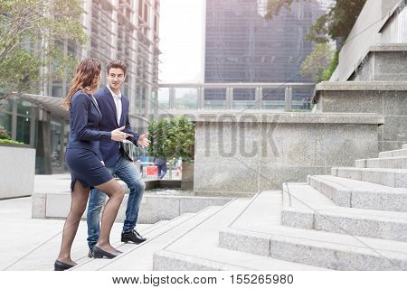 businesspeople walk and talk on the stair in hongkong