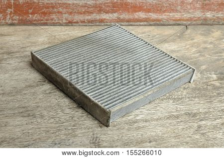 Old air filter of the air condition in the car