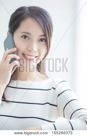 beauty woman talk on phone and look you in hongkong