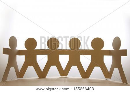 Team of paper doll people
