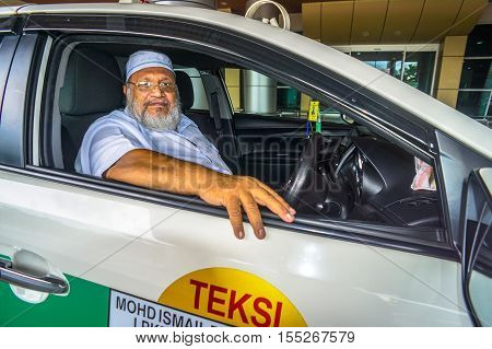 Labuan,Malaysia-Nov 6,2016:Muslim taxi driver on 6th Nov 2016 at Labuan,Malaysia.The popularity of Uber,creates a win for consumers because the competition with taxi services creates better services.