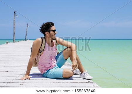 Young man traveling in Holbox island, Mexico.