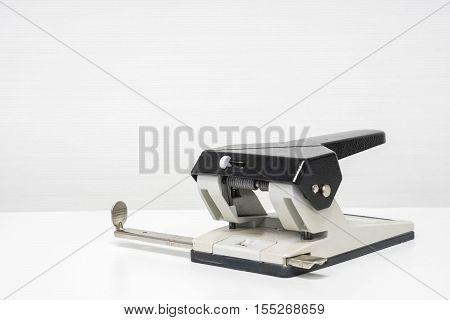 isolated desktop paper punch on office desk