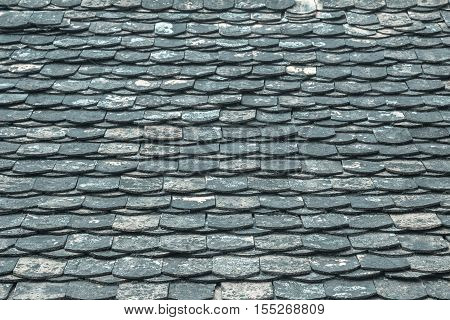 Old architectural Detail of Slate Roof Tiles/renewed Bright summer in the background. top home house modern brick work white outdoors.