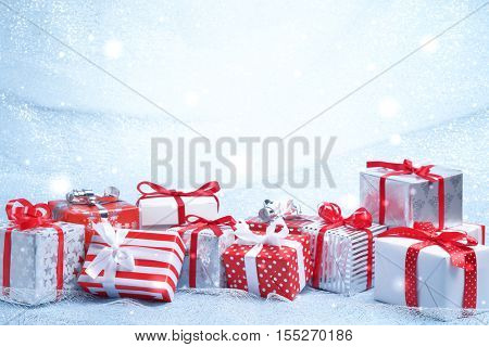 Christmas gift boxes on abstract background