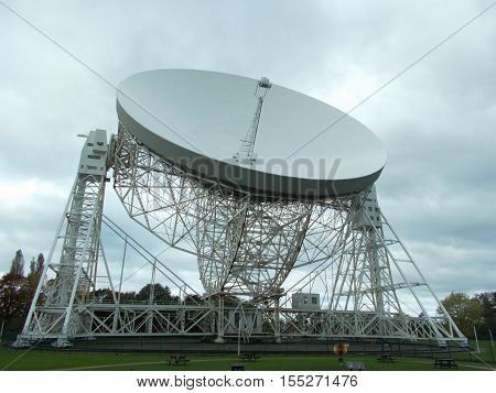 Radio telescope at Jodrell bank in cheshire England.   This is a listening device listening for signs of intelligent life from outer space.
