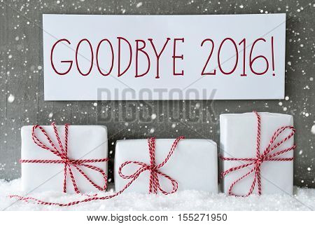 Three Christmas Presents On Snow. Cement Wall As Background With Snowflakes. Modern And Urban Style. Card For Birthday Or Seasons Greetings. Label With English Text Goodbye 2016 For Happy New Year