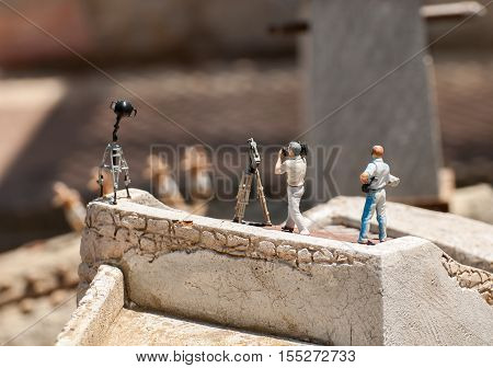 MINI ISRAEL MINIATURE PARK, LATRUN, ISRAEL - MAY  10, 2011: Cameramen and reporter in Mini Israel - a miniature park located near Latrun