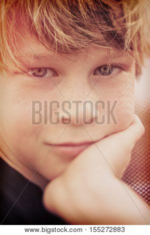 Smiling boy, shallow tilt shift focus on left eye