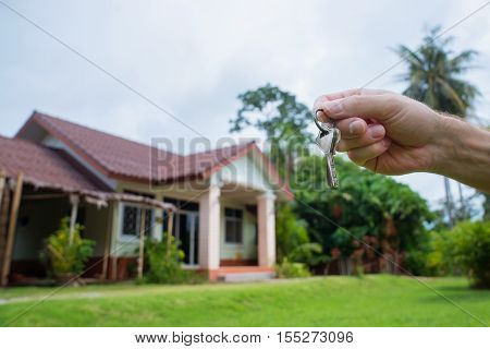 Holding in his hand the keys of the house. Buying selling renting house.