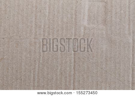 Texture of the brown paper box or cardboard for the design background.