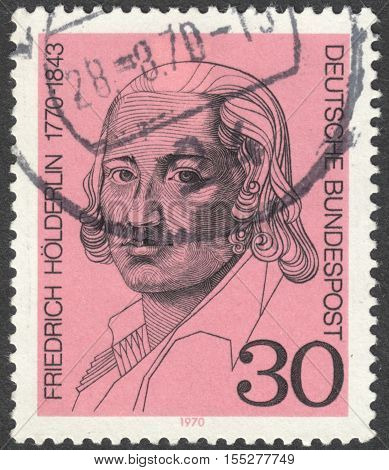 MOSCOW RUSSIA - CIRCA OCTOBER 2016: a post stamp printed in GERMANY shows a portrait of Friedrich Hoelderlin the series