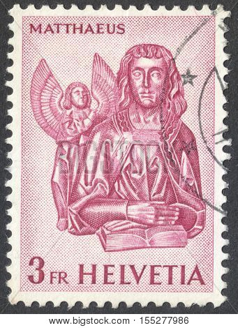 MOSCOW RUSSIA - CIRCA OCTOBER 2016: a post stamp printed in SWITZERLAND shows St. Matthew with the angel the series