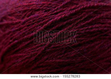 Vinous knitting thread texture, handiwork backdrop. Bright handiwork background, crochet woolen string, Leisure, hobby, needlework concept