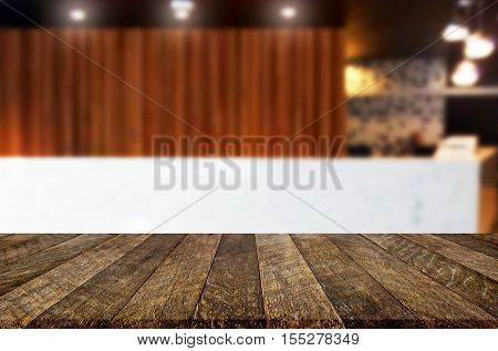 Image Of Wooden Table In Front Of Abstract Blurred Background Of Resturant Lights For Display Or Mon